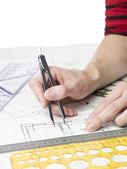 Architect working on a blueprint — Stock Photo