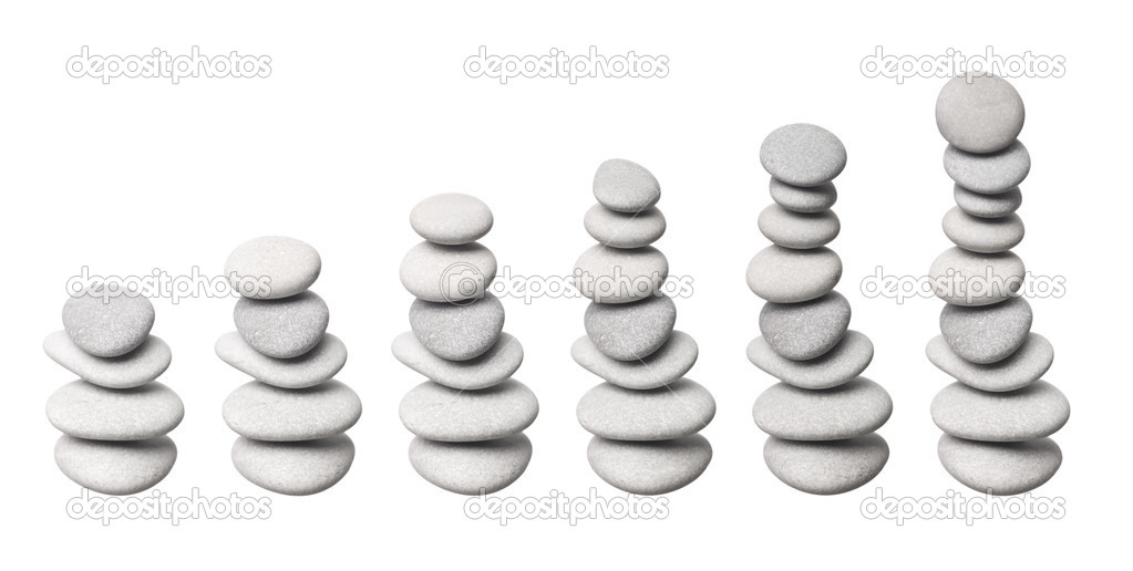 Stacked stones in progress, isolated on white background — Photo #2064351