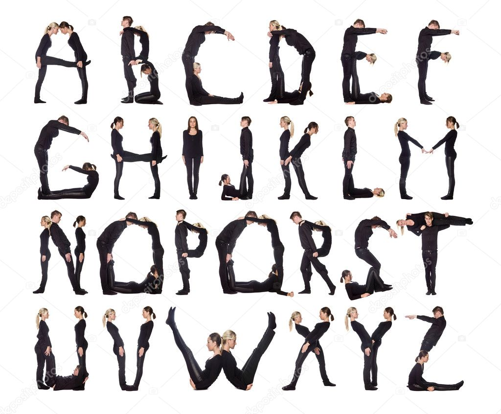 Group of black dressed forming the alphabet. — Stock Photo #2069693