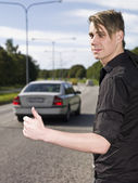 Hitchhiking man — Stock Photo
