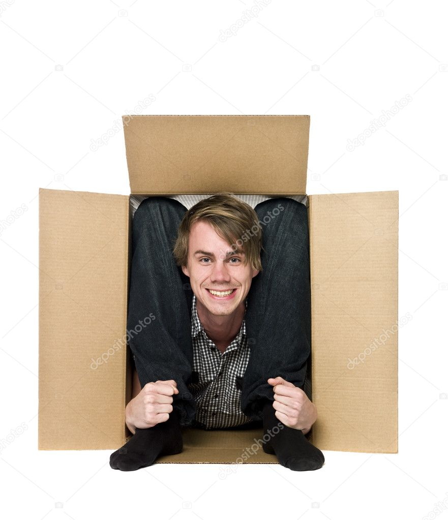 Acrobat inside of a cardboard box. — Stock Photo #2096735