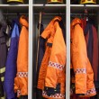 Foto Stock: Firefighter suits