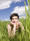 Woman in grass — Stock Photo