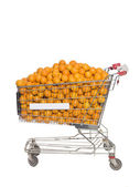 Shopping Cart with oranges — Stock Photo