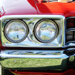 Stock Photo: Head lights and chrome bumper