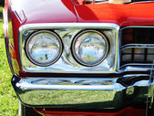 Head lights and chrome bumper — Stock Photo