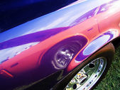 Muscle car reflected onto another — Stock Photo