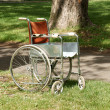 Stock Photo: Old wheelchair in park