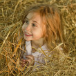Playing in the hay — Stockfoto