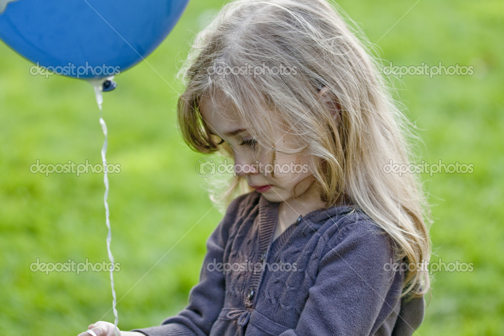 Little Blond Sad Girl Holding A Blue Balloon — Stock Photo #2375520