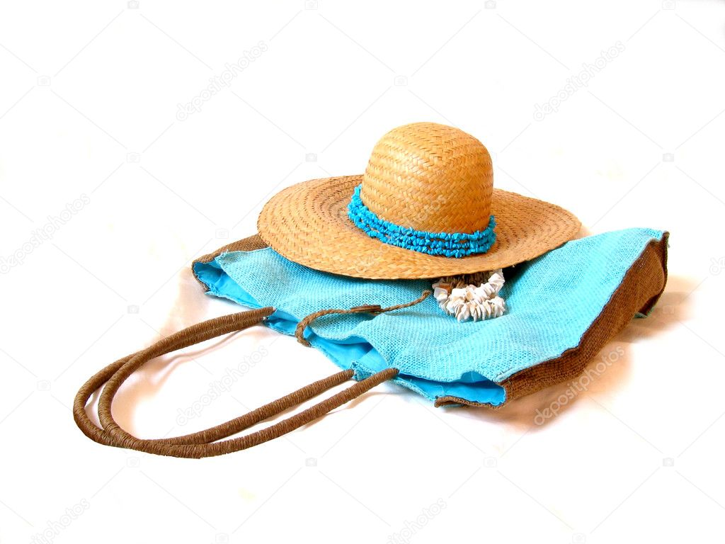 Beach hat with turqouise and handbag in the same color — Stock Photo #2015697