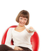 Happy young woman watching TV — Stock Photo
