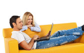 Happy couple with laptop computer — Stock Photo