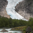 Stock Photo: Cascading stream at Briksdal glacier