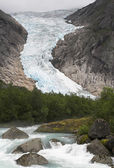 Cascading stream at Briksdal glacier — Stock Photo