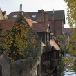 Ancient houses on a channel in Brugge — Stock Photo