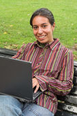 Smiling girl with computer — Stock Photo