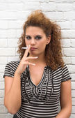 Smoking brunette — Stock Photo