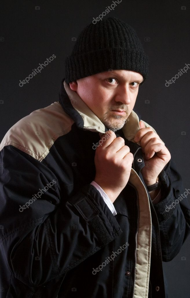 Portrait of a man on dark background in outdoor clothes  Stock Photo #2124895