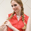 Pretty blonde girl playing with plaits — Stock Photo #2145191