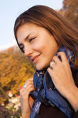 Happy young woman in an autumn park — Stock Photo