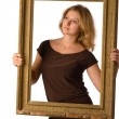 Stock Photo: Pretty blonde girl with old frame