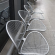 Raw of metal chairs — Stock Photo