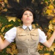 Lying on golden leaves — Stock Photo