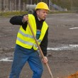 Stock Photo: Construction worker digging ground