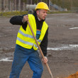 Construction worker digging ground - Stock Photo