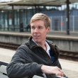 Young blond man in railway station — Stock Photo #2672353