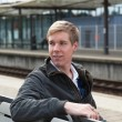 Stock Photo: Young blond min railway station