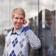Stock Photo: Happy young man with cellphone
