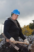 Female manual worker in blue hard hat — Stock Photo
