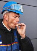 Smoking worker — Stock Photo