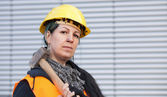 Female manual worker with hammer — Stock Photo