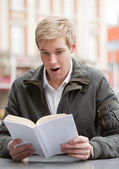 Young guy with book — Stock Photo