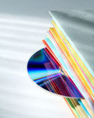 Multicolored brochures and disk — Stock Photo