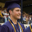 Stock Photo: High school graduate in cap and gown