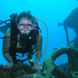 Female scuba diver on ship wreck dive site — Stock Photo