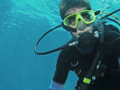 Young scuba diver underwater — Stock Photo