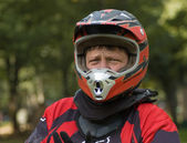 Serious motocross rider geared up — Stock Photo