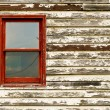Old Red Window in Paint Peeling Building — Stock Photo