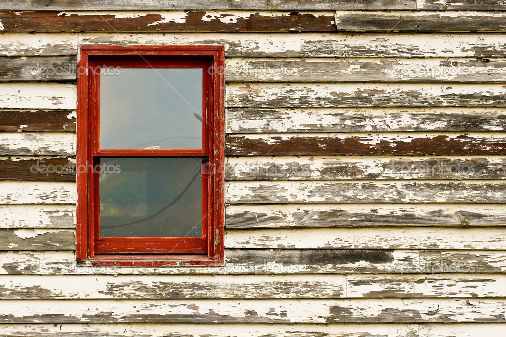 An old building with peeling paint and a red window — Stock Photo #2061336