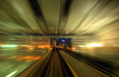 Speedy trains passing train station — Stock Photo