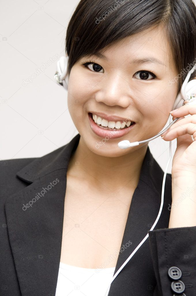 Friendly Customer Representative with headset smiling during a telephone conversation. — Stock Photo #2360638