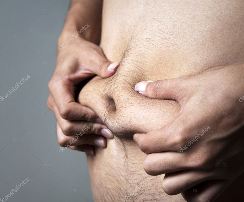 A man pinches his body fat.  Stock Photo #2361816