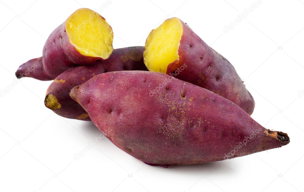 Cooked whole and halved purple sweet potatoes.  Stock Photo #2363351