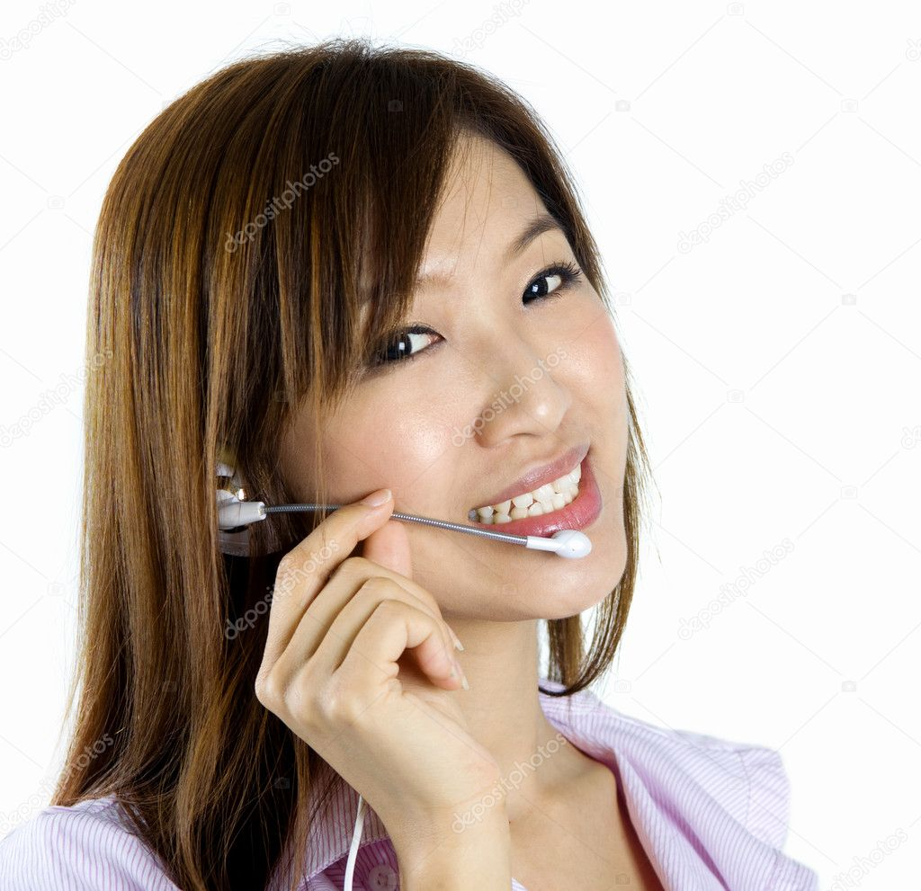 Friendly Customer Representative with headset smiling during a telephone conversation. — Foto de Stock   #2367143