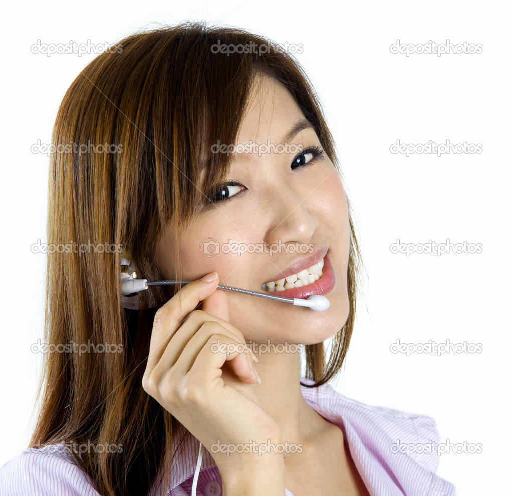 Friendly Customer Representative with headset smiling during a telephone conversation.  Photo #2367143
